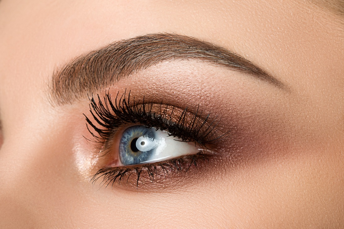 Close,Up,Of,Blue,Woman,Eye,With,Beautiful,Brown,With